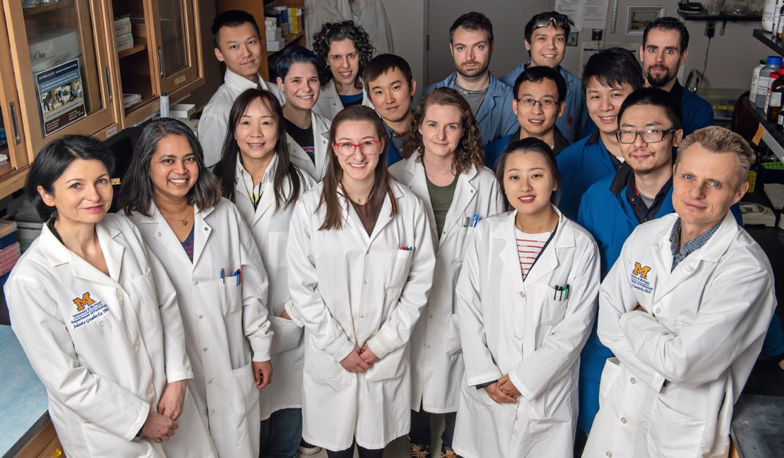 Jolanta Grembecka, PhD (far left), and Tomasz Cierpicki, PhD (far right), with their Lab Team.<br /><strong>Photo by</strong> Leisa Thompson